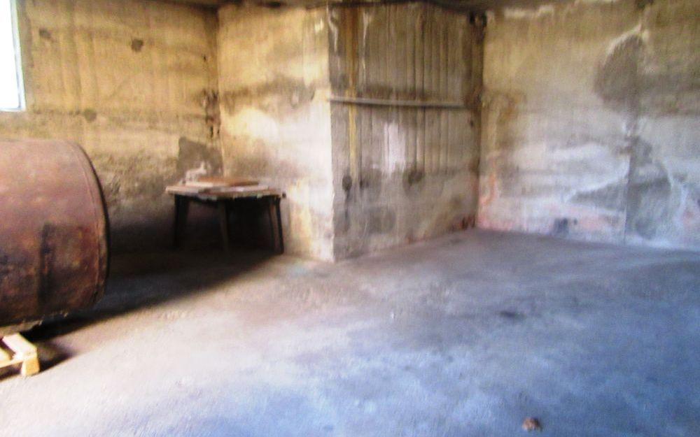Maison avec balcon : garage